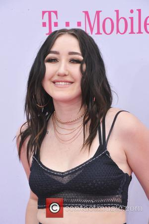 Noah Cyrus on the red carpet at the 2017 Billboard Music Awards held at T-Mobile Arena. Drake walked away as...