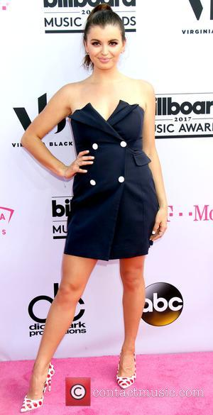 Rebecca Black on the red carpet at the 2017 Billboard Music Awards held at T-Mobile Arena. Drake walked away as...