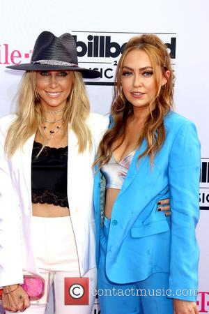 Tish Cyrus on the red carpet at the 2017 Billboard Music Awards held at T-Mobile Arena. Drake walked away as...