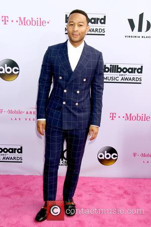 John Legend on the red carpet at the 2017 Billboard Music Awards held at T-Mobile Arena. Drake walked away as...