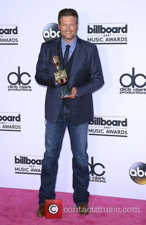 Blake Shelton holding his award at the 2017 Billboard Music Awards held at T-Mobile Arena. Drake walked away as the...