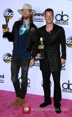 Florida Georgia Line holding their awards at the 2017 Billboard Music Awards held at T-Mobile Arena. Drake walked away as...