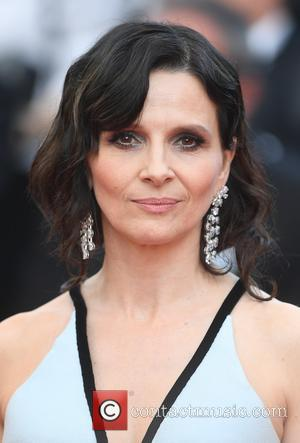 Juliette Binoche at the 70th Cannes Film Festival 70th Anniversary Soiree held at Palais des Festivals - Cannes, United Kingdom...