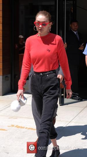 Gigi Hadid wears bright red spectacles as she leaves her apartment - Manhattan, New York, United States - Wednesday 31st...