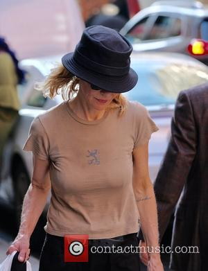 Meg Ryan shows off her a tattoo that reads 'Life is Short' located on her inner lower arm - Manhattan,...