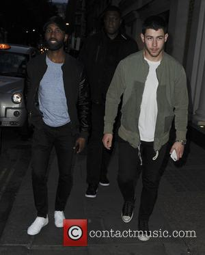 Joe Jonas seen out and about in London before entering the Sexy Fish Restaurant - London, United Kingdom - Saturday...