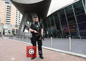 Armed police patrol at the Lowry Theatre before  the British Soap Awards - Salford Quays, Manchester, United Kingdom -...