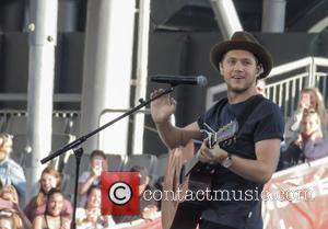 Niall Horan seen on stage at Ariana Grande's One Love Manchester concert - The concert was set up to benefit...