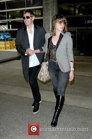 Milla Jovovich and her husband, film director Paul W. S. Anderson seen at Los Angeles International Airport - Los Angeles,...