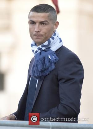 Cristiano Ronaldo at the Real Madrid parade around Plaza de Cibeles after winning the UEFA Champions League against Juventus -...