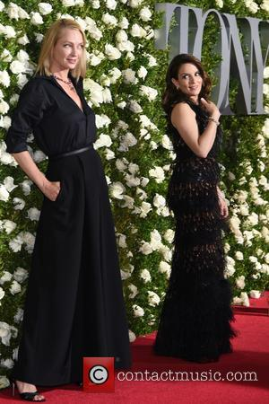 Uma Thurman looks stunning in a long black dress on the red carpet at the 71st Tony Awards held Radio...