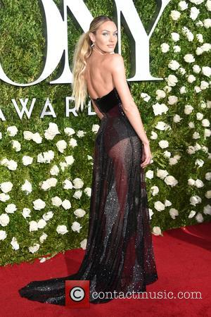 candice swanepoel on the red carpet at the 71st Tony Awards held Radio City Music Hall - Manhattan, New York,...