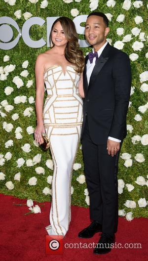 Chrissy Teigen and John Legend on the red carpet at the 2017 Tony Awards held Radio City Music Hall -...