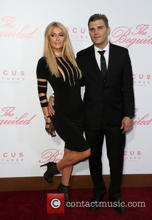 Paris Hilton and Chris Zylka at the U.S. Premiere Of