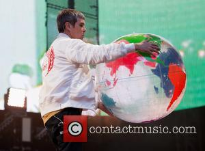 Ian Brown of The Stone Roses seen on stage playing to a crowd of 90,000 at the sold-out concert. -...