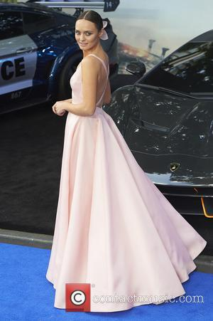 Laura Haddock wears a long pink satin dress to the Transformers: The Last Knight world premiere - London, United Kingdom...
