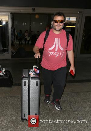 Jack Black smiles for the cameras as he arrives at LAX - Los Angeles, California, United States - Tuesday 20th...