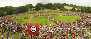 Glastonbury Festival goers attempt to break a world record by forming a huge Peace sign - Somerset, United Kingdom -...