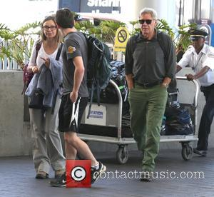 Harrison Ford and Calista Flockhart arrive at LAX Airport to catch a flight with their son Liam - Los Angeles,...