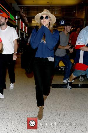 Elizabeth Olsen arriving at LAX Airport - Los Angeles, California, United States - Tuesday 11th July 2017