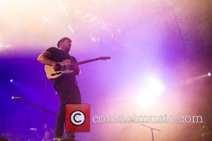Marcus Mumford and the rest of Mumford & Sons perform at Latitude Festival on the third day - held at...