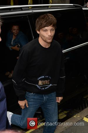 Louis Tomlinson arrives at The Kiss FM Studios where many fans had queued for hours - London, United Kingdom -...