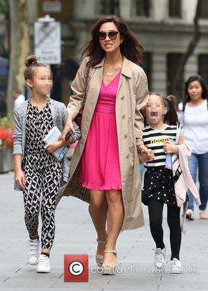 Myleene Klass arrives at Global Radio studios with her daughters Ava and Hero at Global Radio Studios - London, United...