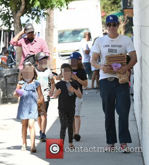 Johnny Knoxville buys pizza and snow cones for his kids Rocko Clapp, Arlo Clapp and their friends at the Farmers...