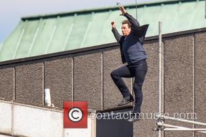 Tom Cruise leaps from the roof of one building to another while filming the next film in the 'Mission: Impossible'...