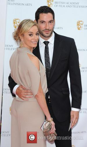 FILE PHOTO British acting couple Tamzin Outhwaite and Tom Ellis have split after seven years of marriage. The pair announced...