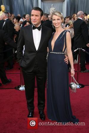 Jean Dujardin, Alexandra Lamy 84th Annual Academy Awards (Oscars) held at the Kodak Theatre - Arrivals Los Angeles, California -...