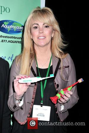 Dina Lohan introduces the 'Aqua Freedom Green Lohan Toothbrush' at Pier 92  Featuring: Dina Lohan Where: New York City,...