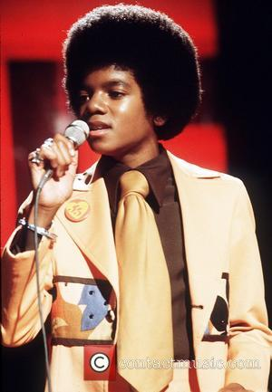 A young Michael Jackson on stage in London circa 1974. London, England - 1974  Where: London, United Kingdom When:...