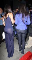 Kourtney Kardashian and her sister Kim Kardashian