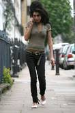 Amy Winehouse leaving her house to go shopping...