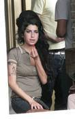 Amy Winehouse in the pub with her husband...