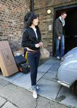 Amy Winehouse leaving her new residence to visit...
