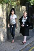 Amy Winehouse leaving her house with a female...