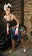 Amy Winehouse, wearing pink gloves, did some spring cleaning at her house. She takes a break and asks photographers for money for her driver.