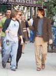 Ashton Kutcher walks to her trailer after filming...