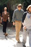 Ashton Kutcher takes his dog for a walk...