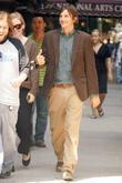 Ashton Kutcher walks to his trailer after filming...