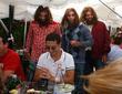 Cavemen storm swanky Ivy Restaurant Three actors dressed...