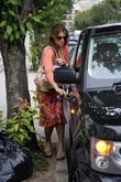 Elizabeth Hurley leaving home wearing a bright floral...