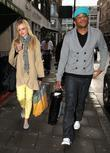 Fearne Cotton, Reggie Yates leave the Radio One studios, after their Saturday Request Show. Fearne was dressed for Spring, wearing bright yellow trousers, ballet pumps and as well as rather geeky looking plastic spectacles