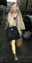 Fearne Cotton, Reggie Yates leave the Radio 1 studios, after their Saturday request show. Fearne was dressed for spring, wearing bright yellow trousers, ballet pumps and as well as rather geeky looking plastic spectacles!