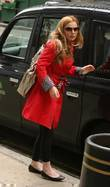 Geri Halliwell getting out of a taxi while...