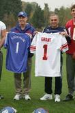 New York Giants head coach Tom Coughlin exchanges team jerseys with Chelsea Football Club manager Avram Grant