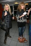 Jennifer Ellison and Tracey Ann-Oberman buying a parking ticket in an underground car park