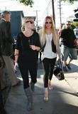 Lindsay Lohan and her assistant go to Orso Restaurant in West Hollywood